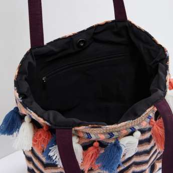 Embroidered Tote Bag with Tassel Detail and Magnetic Snap Closure