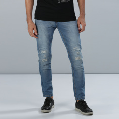 Distressed Full Length Jeans in Slim Fit