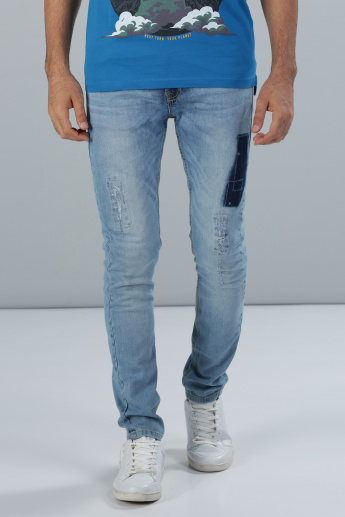 Full Length Distressed Jeans with Patch Detail