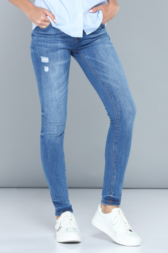 Distressed Full Length Jeans with Button Closure