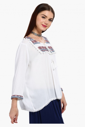 Embroidered Long Sleeves Textured Top with Pom Poms