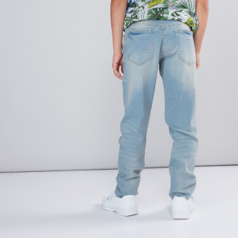 Distressed Jeans with Zip Closure and Pocket Detail