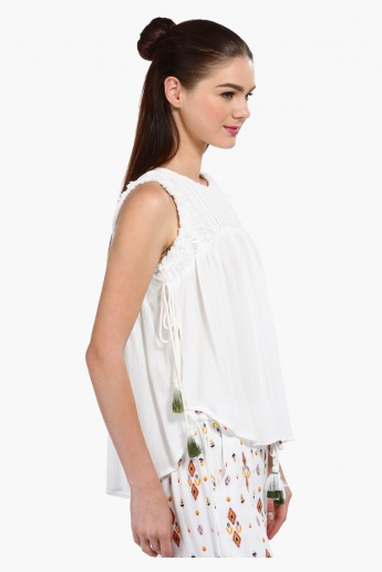 Sleeveless Top with Tasselled Sides
